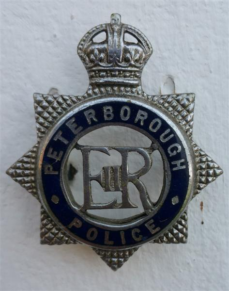 Pboro Officers badge.jpg