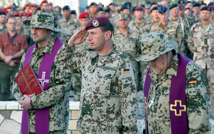 German_military_Chaplains_during_a_funeral_service_at_ISAF.jpg