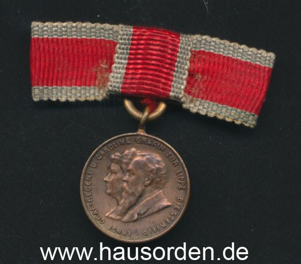 Lippe-1897 Medaille Miniatur-Damenschleife-VS web.jpg