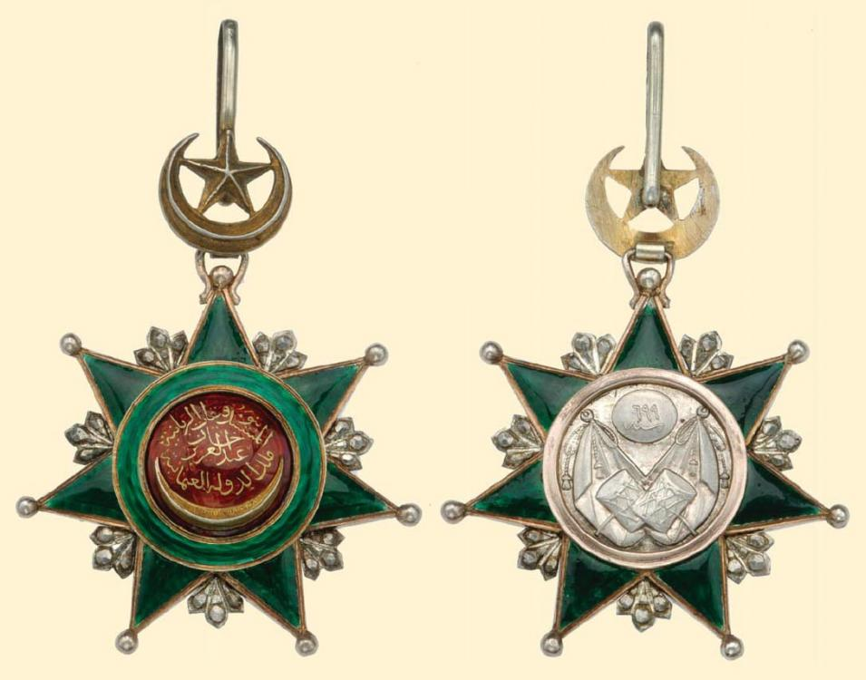 osmani 1344 Commander's Decoration (3rd class), neck badge, silver, gold & enamel. Averse medallion with gold onlay, crescent & star above, with suspension loop..jpg