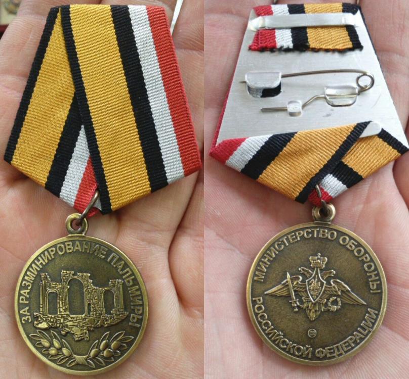 medal in hand.jpg