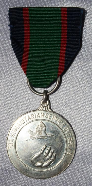Trinidad & Tobago Defense Force Medal For Humanitarian Service Oversea's obverse small size.JPG