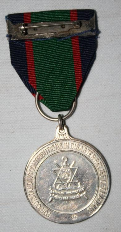 Trinidad & Tobago Defense Force Medal For Humanitarian Service Oversea's reverse small size.JPG