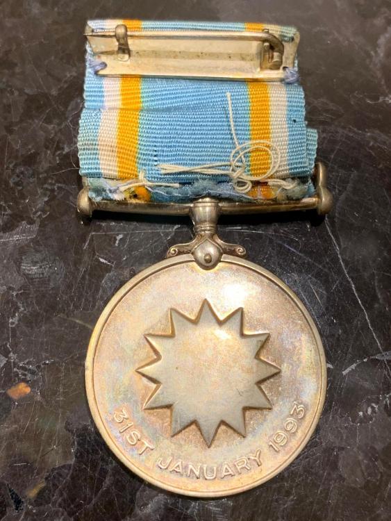 Nauru Medal for 25 Years Independence reverse.jpeg