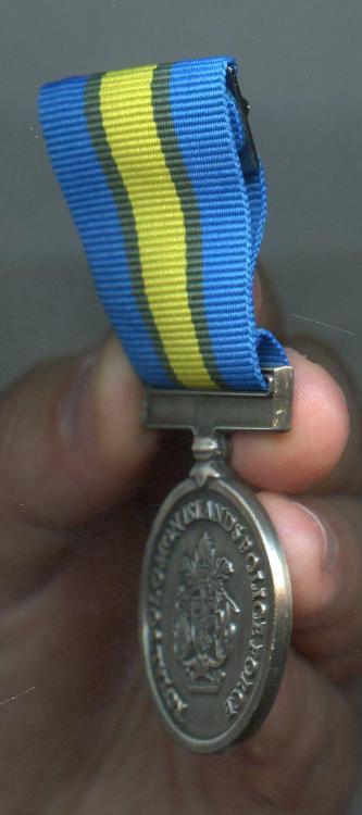 Solomon Isl Royal Solomon Islands Police Force International Law Enforcement Cooperation Medal side.jpg