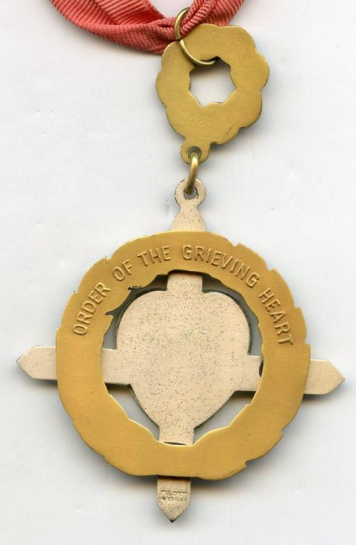 Philippines Order of the Grieving Heart reverse.jpg