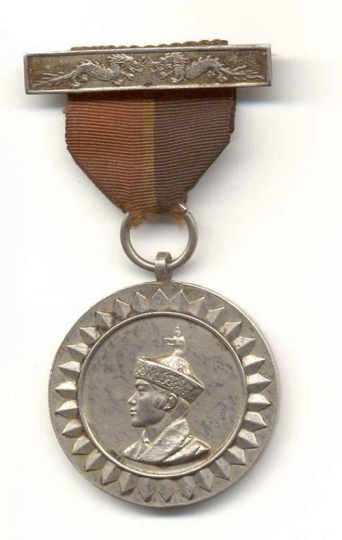Bhutan Coronation 1974 Medal King Jigme Singye Wangchuk 1st issue obverse.jpg