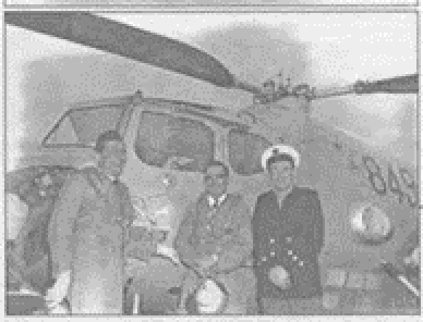 LCDR Salthouse (centre) posing in front of a Sycamore 849..png