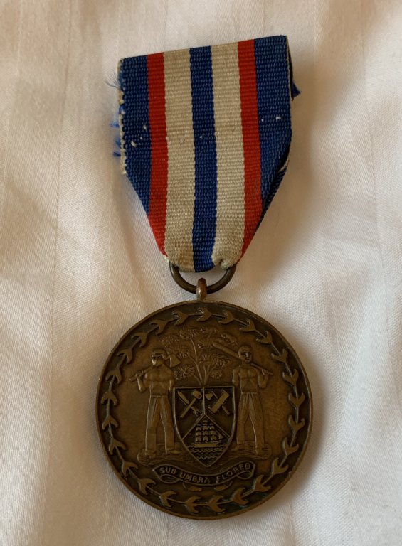 Belize 15 th Anniversary BDF Medal obverse.png