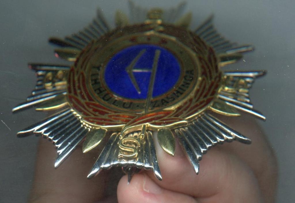 Swaziland Order of Sobhuza II Grand Commander breast star side obverse.jpg