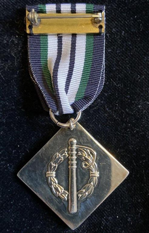 Zambia Police Medal of Merit Deputy Inspector General reverse.jpg